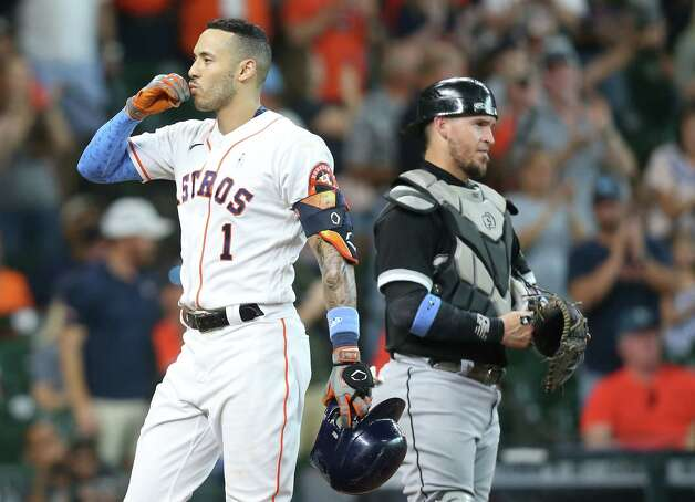 Houston Astros shortstop Carlos Correa (1) blows a kiss into the stands after running is a solo home run against Chicago White Sox in the fourth inning at Minute Maid Park in Houston on Sunday, June 20, 2021. Photo: Elizabeth Conley, Staff Photographer / © 2021 Houston Chronicle
