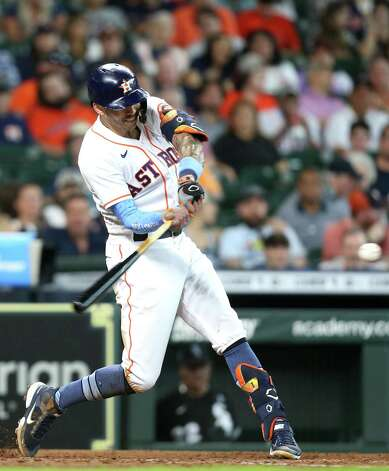 Houston Astros shortstop Carlos Correa (1) connects for a solo home run in the fourth inning against Chicago White Sox at Minute Maid Park in Houston on Sunday, June 20, 2021. Photo: Elizabeth Conley, Staff Photographer / © 2021 Houston Chronicle