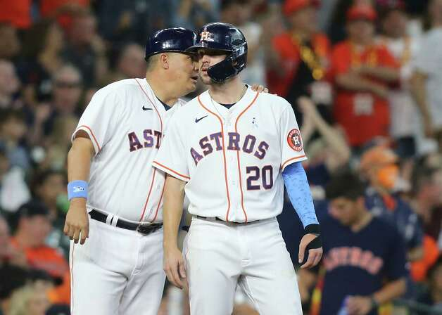Houston Astros catcher Jason Castro (18) talks to Chas McCormick (20) in the fifth inning against Chicago White Sox at Minute Maid Park in Houston on Sunday, June 20, 2021. Photo: Elizabeth Conley, Staff Photographer / © 2021 Houston Chronicle