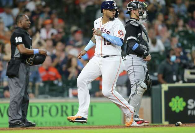 Houston Astros catcher Martin Maldonado (15) looks back as he runs in to home during the fifth inning against Chicago White Sox at Minute Maid Park in Houston on Sunday, June 20, 2021. Photo: Elizabeth Conley, Staff Photographer / © 2021 Houston Chronicle