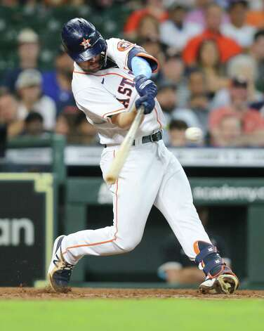 Houston Astros right fielder Chas McCormick (20) connects for a single in the fifth inning at Minute Maid Park in Houston on Sunday, June 20, 2021. Photo: Elizabeth Conley, Staff Photographer / © 2021 Houston Chronicle