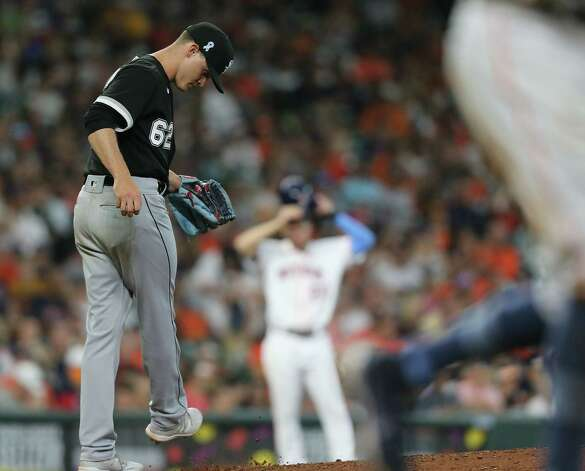Chicago White Sox relief pitcher Zack Burdi (62) reacts to walking Houston Astros shortstop Carlos Correa (1) loading the bases in the fifth inning at Minute Maid Park in Houston on Sunday, June 20, 2021. Photo: Elizabeth Conley, Staff Photographer / © 2021 Houston Chronicle