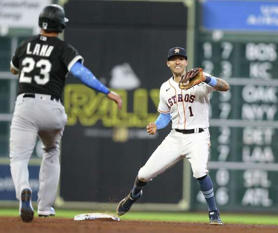 Houston Astros shortstop Carlos Correa (1) gets Chicago White Sox third baseman Jake Lamb (23) out at second in the fifth inning at Minute Maid Park in Houston on Sunday, June 20, 2021. Photo: Elizabeth Conley, Staff Photographer / © 2021 Houston Chronicle
