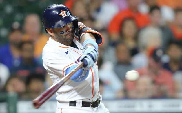 Houston Astros second baseman Jose Altuve (27) connects for a long out in the fifth inning against Chicago White Sox at Minute Maid Park in Houston on Sunday, June 20, 2021. Photo: Elizabeth Conley, Staff Photographer / © 2021 Houston Chronicle