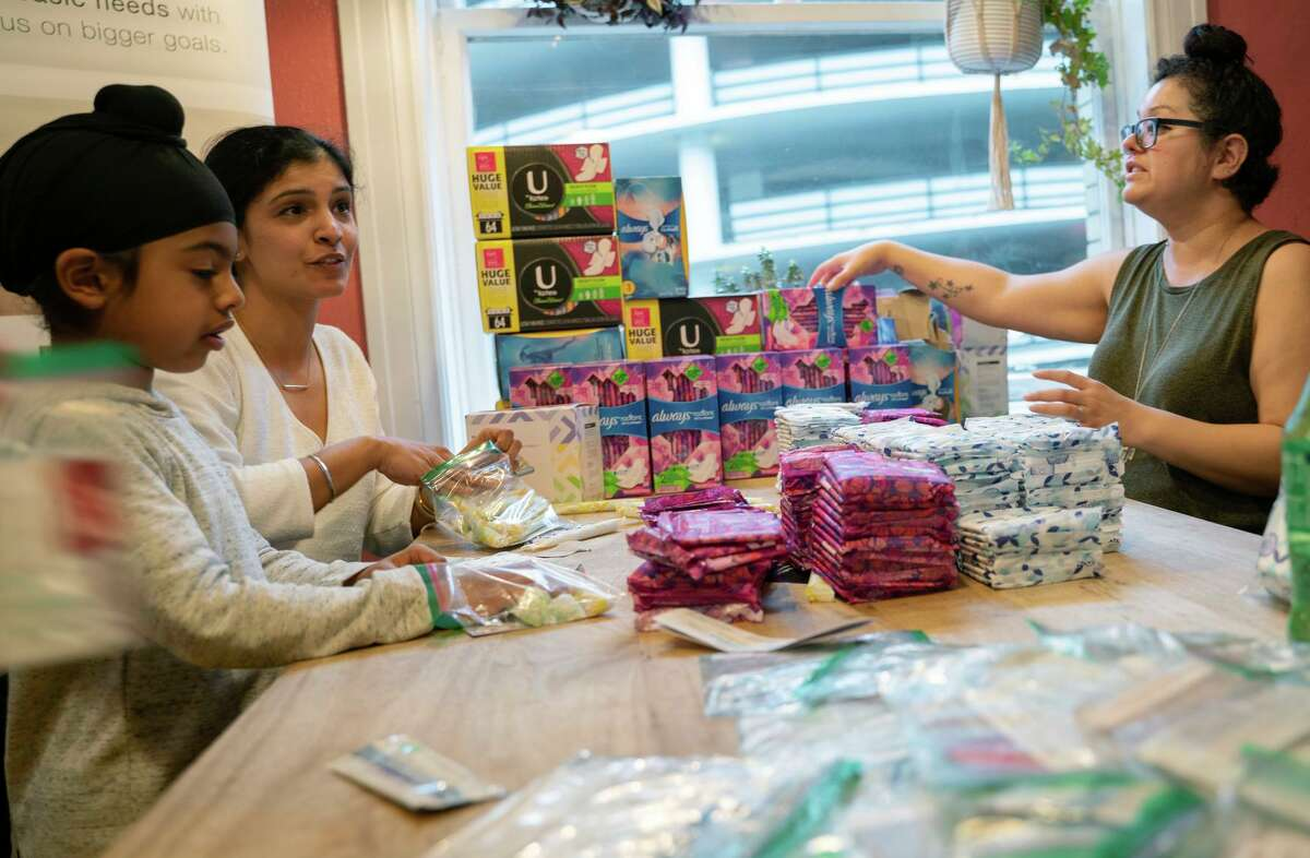 Volunteers in S.F. organize feminine hygiene products to donate to Bay Area schools and homeless shelters in 2019.