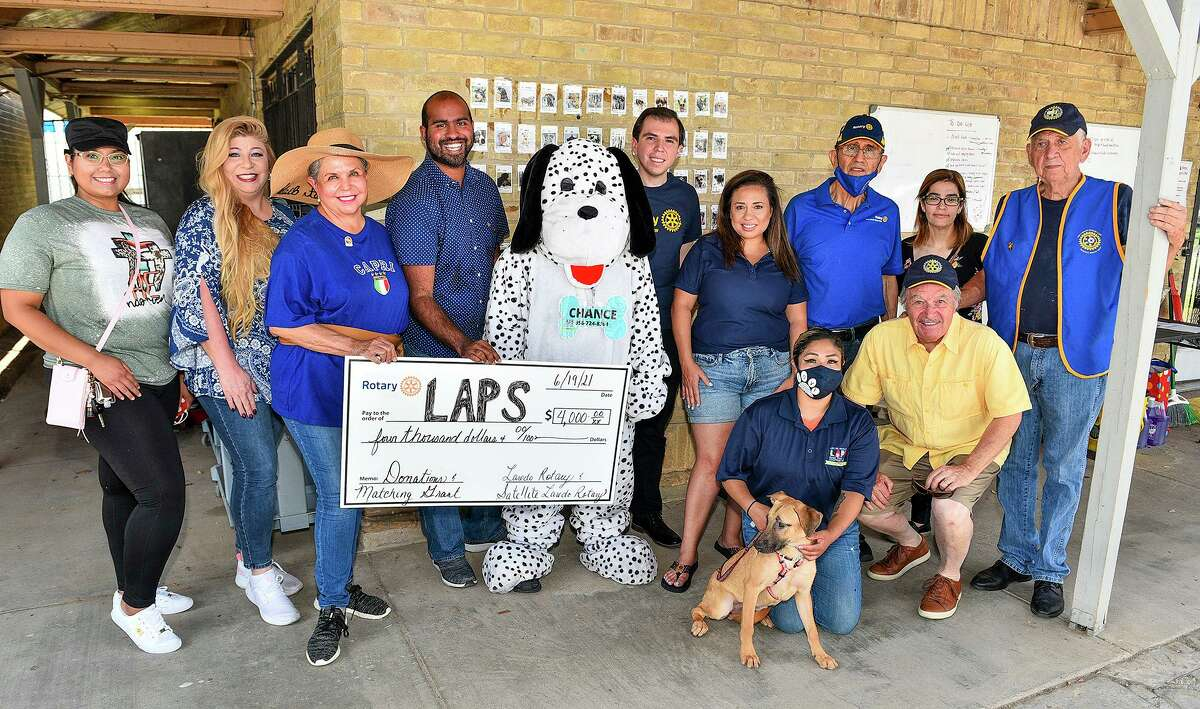 Representatives from the Laredo Animal Protective Society, Laredo Rotary, Satellie Laredo Rotary and Next Gen Rotary gather for a photo Saturday as rotarians present LAPS with a donation of $4,000.