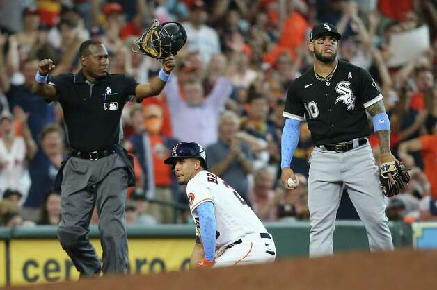 Houston Astros left fielder Michael Brantley (23) is safe at third after hitting a triple against Chicago White Sox in the seventh inning at Minute Maid Park in Houston on Sunday, June 20, 2021. Photo: Elizabeth Conley, Staff Photographer / © 2021 Houston Chronicle