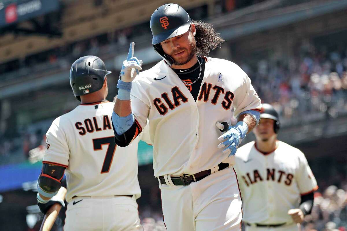 San Francisco Giants' Brandon Crawford reacts after hitting 2-run home run in 3rd inning against Philadelphia Phillies during MLB game at Oracle Park in San Francisco, Calif., on Sunday, June 20, 2021.