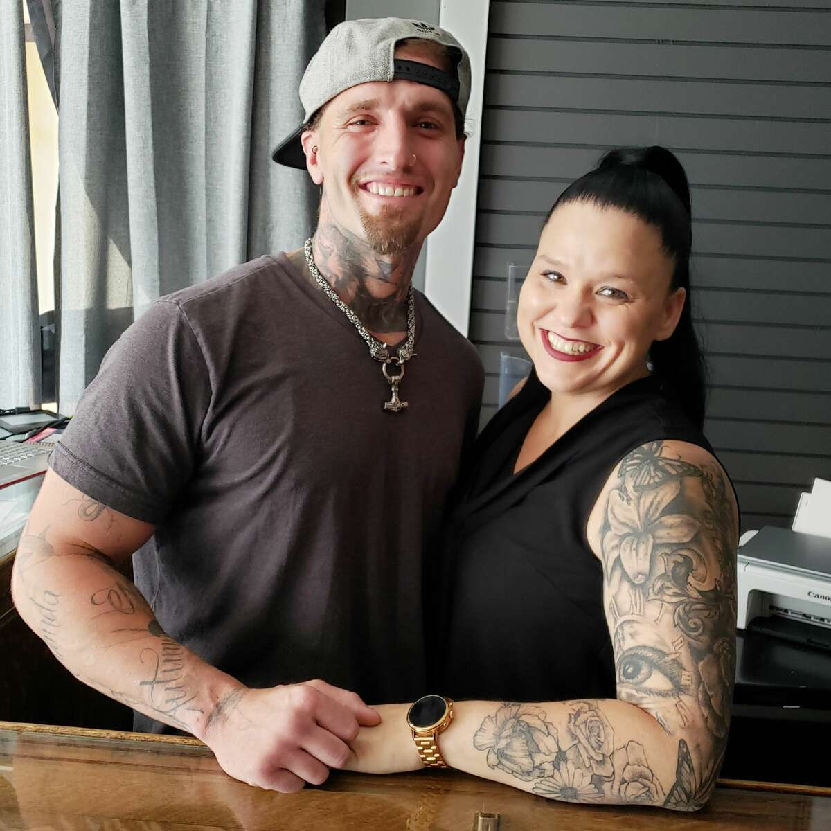 (From left) Tattoo artist Brandon Mecam and Clean Lines Tattoo Company co-owner Kelly Stoudt are shown in their newly opened shop at 336 River Street, in Manistee.