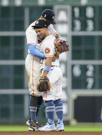 Houston Astros shortstop Carlos Correa (1) and Houston Astros second baseman Jose Altuve (27) have a moment after the team's 8-2 win over Chicago White Sox at Minute Maid Park in Houston on Sunday, June 20, 2021. Houston Astros won the game 8-2. Photo: Elizabeth Conley, Staff Photographer / © 2021 Houston Chronicle