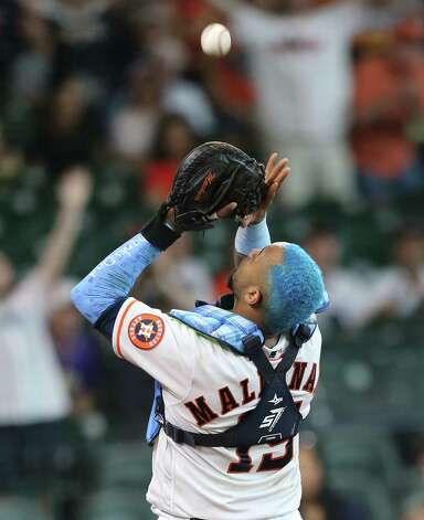 Houston Astros catcher Martin Maldonado (15) gets the last out of the ninth inning for the Chicago White Sox at Minute Maid Park in Houston on Sunday, June 20, 2021. Houston Astros won the game 8-2. Photo: Elizabeth Conley, Staff Photographer / © 2021 Houston Chronicle
