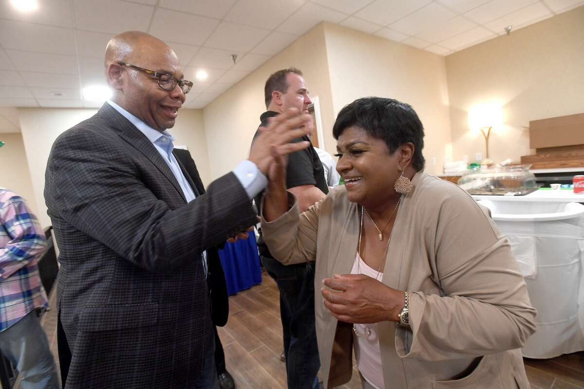 Robin Mouton gathers with supporters, including Rev. John Adolph, at her watch party in Beaumont's mayoral run-off election Saturday. Photo made Saturday, June 19, 2021 Kim Brent/The Enterprise