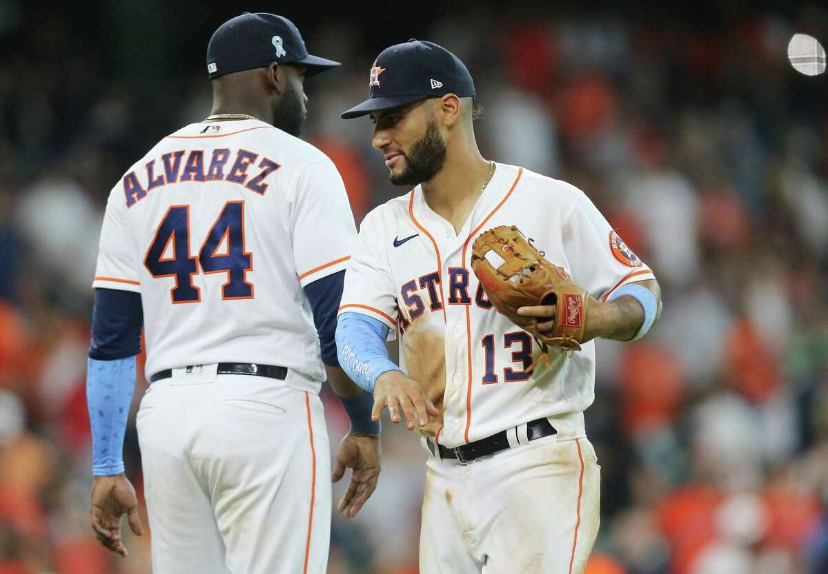 Designated hitter Yordan Alvarez and third baseman Abraham Toro, who both contributed to a five-run third inning against Dallas Keuchel on Sunday, celebrate the Astros' 8-2 victory and four-game sweep of the White Sox.