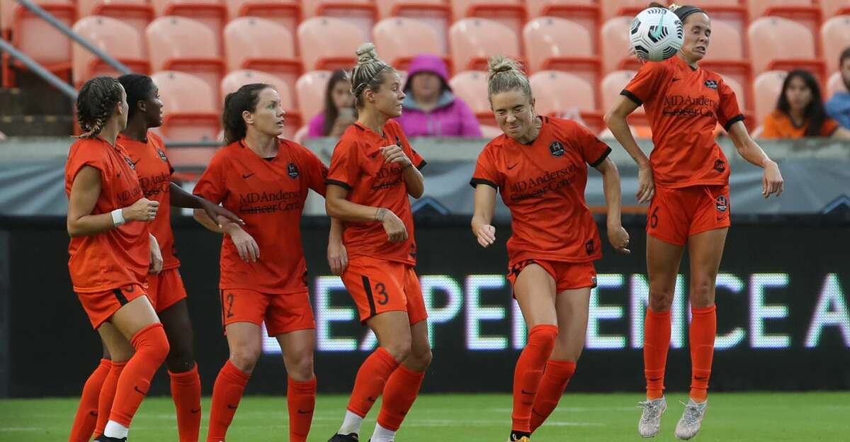 Houston Dash players try to block a penalty kick during the second half of an NWSL match Sunday, May 23, 2021, at BBVA Stadium in Houston.