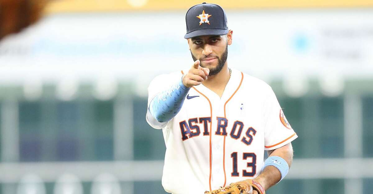 Houston Astros third baseman Abraham Toro (13) points at Houston Astros shortstop Carlos Correa (1) after getting Chicago White Sox left fielder Brian Goodwin (18) out in the fourth inning at Minute Maid Park in Houston on Sunday, June 20, 2021.