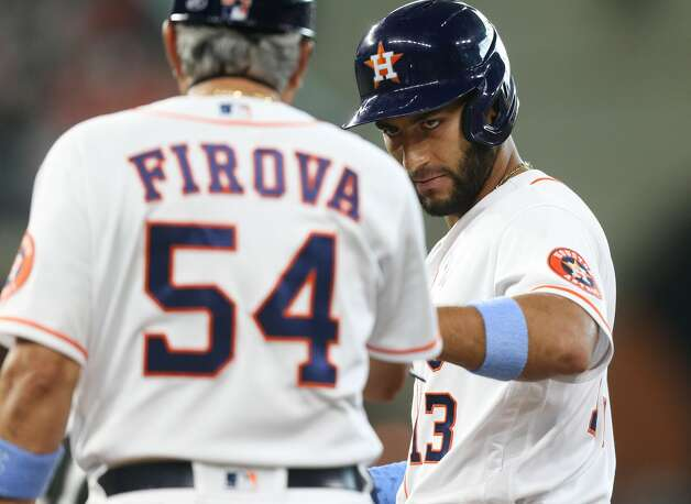 Houston Astros third baseman Abraham Toro (13) is congratulated by Houston Astros coach Dan Firova (54) after hitting a single in the fourth inning against Chicago White Sox at Minute Maid Park in Houston on Sunday, June 20, 2021. Houston Astros won the game 8-2. Photo: Elizabeth Conley/Staff Photographer / © 2021 Houston Chronicle