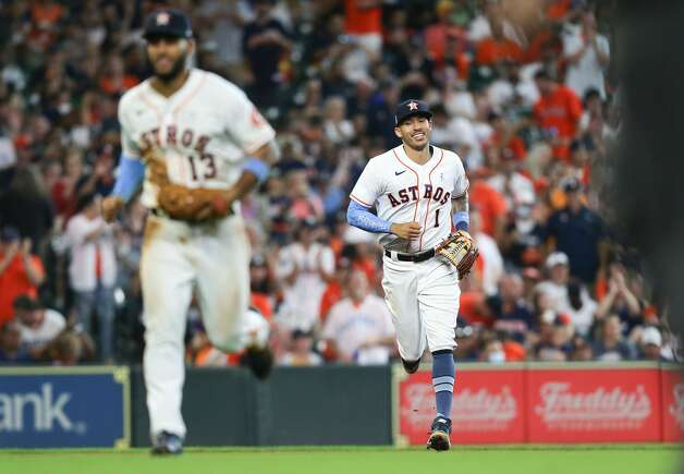 Houston Astros shortstop Carlos Correa (1) is all smiles as he leaves the field against Chicago White Sox in the eighth inning at Minute Maid Park in Houston on Sunday, June 20, 2021. Houston Astros won the game 8-2. Photo: Elizabeth Conley/Staff Photographer / © 2021 Houston Chronicle