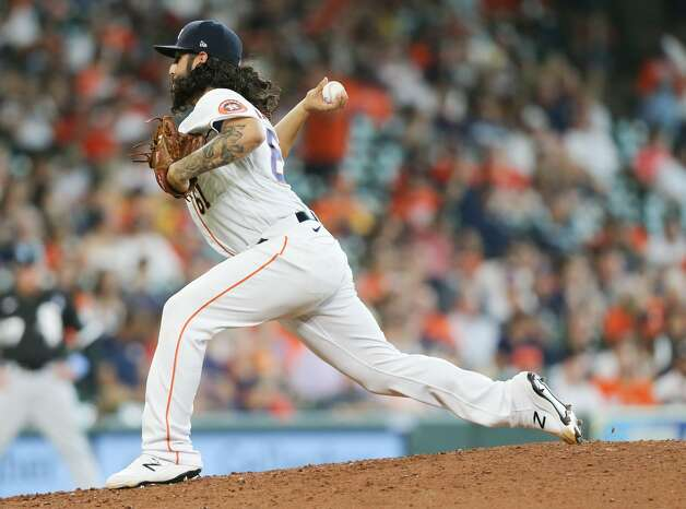 Houston Astros relief pitcher Ralph Garza Jr. (61) pitches inn the ninth inning against the Chicago White Sox at Minute Maid Park in Houston on Sunday, June 20, 2021. Houston Astros won the game 8-2. Photo: Elizabeth Conley/Staff Photographer / © 2021 Houston Chronicle