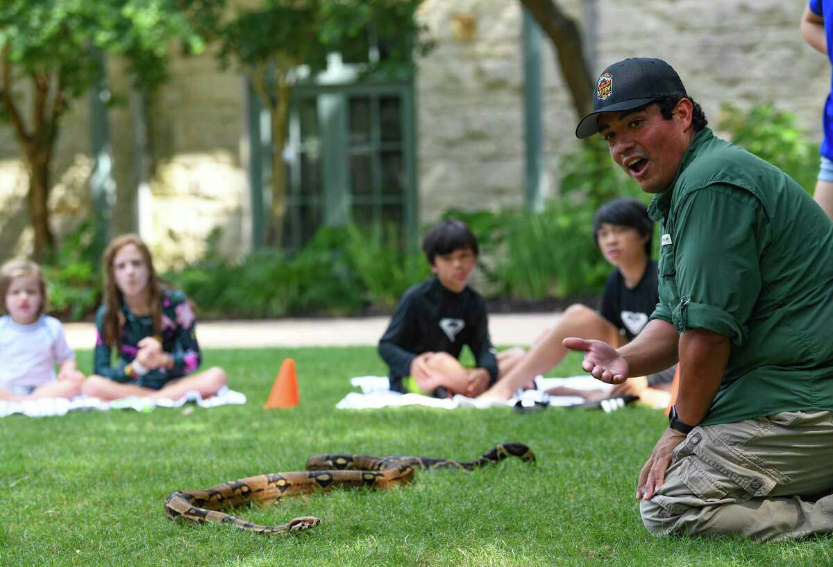 """Clay Carabajal shows a Colombian red-tailed boa at the Hill Country Golf Club at the Hyatt Regency Hill Country Resort and Spa. He also hosts """"The Wild Side with Clay"""" on YouTube."""