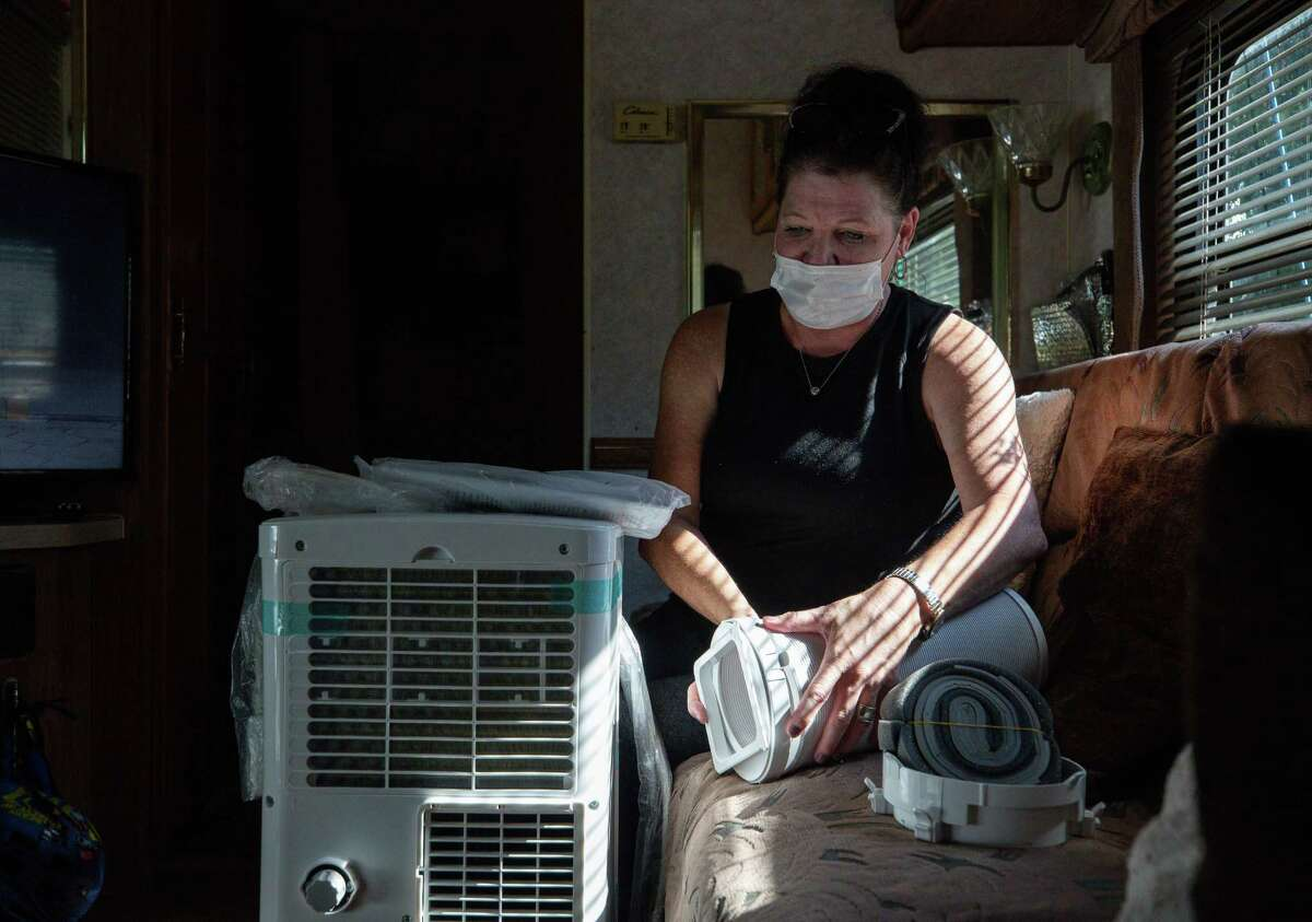 Mary Smith received a new portable air conditioning unit for the RV she and her son live on Friday, June 18, 2021, in Houston.