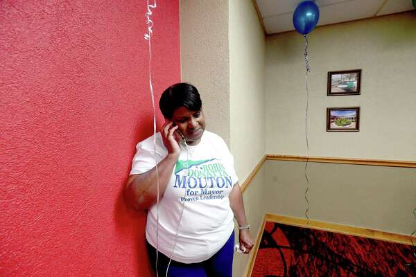 Mayoral candidate Robin Mouton takes a call during her watch party on election day Saturday. Photo made Saturday, May 1, 2021 Kim Brent/The Enterprise