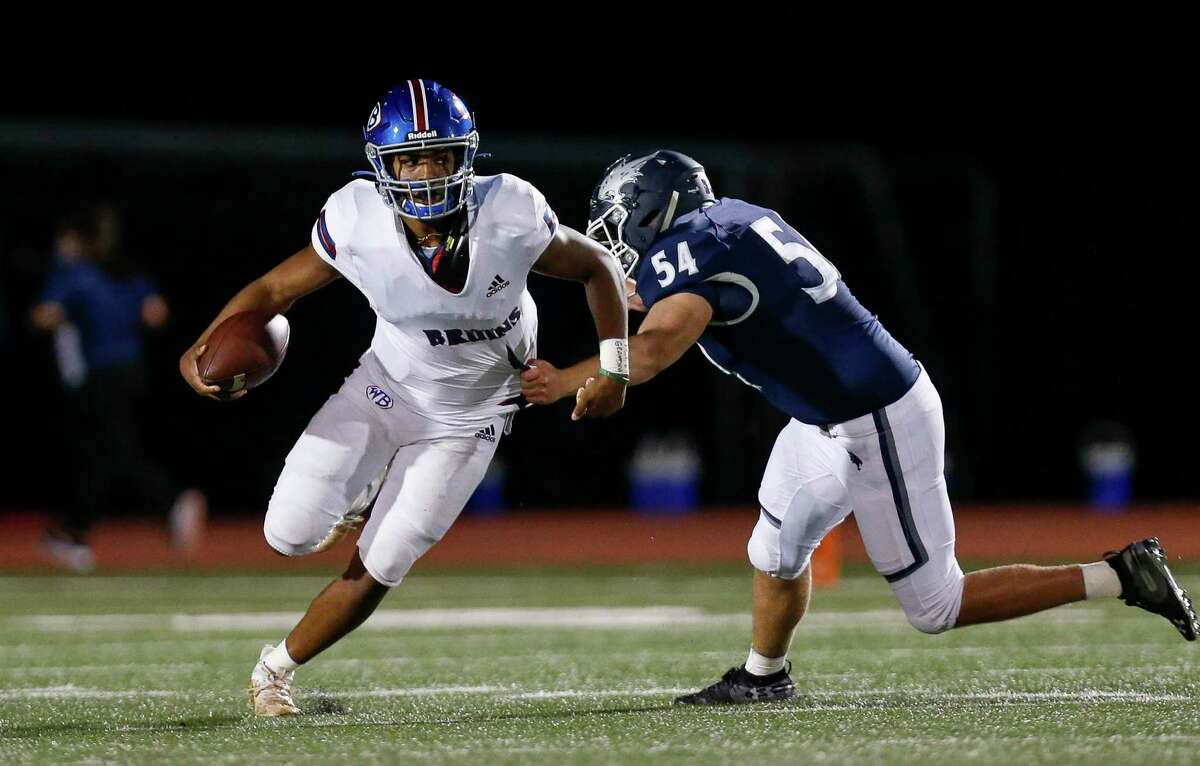 West Brook quarterback Bryce Anderson (1) gets away from Tomball Memorial defensive lineman Matthew Haban (54) during the first half of the game at Tomball ISD Stadium Friday, Oct. 2, 2020, in Tomball, Texas.
