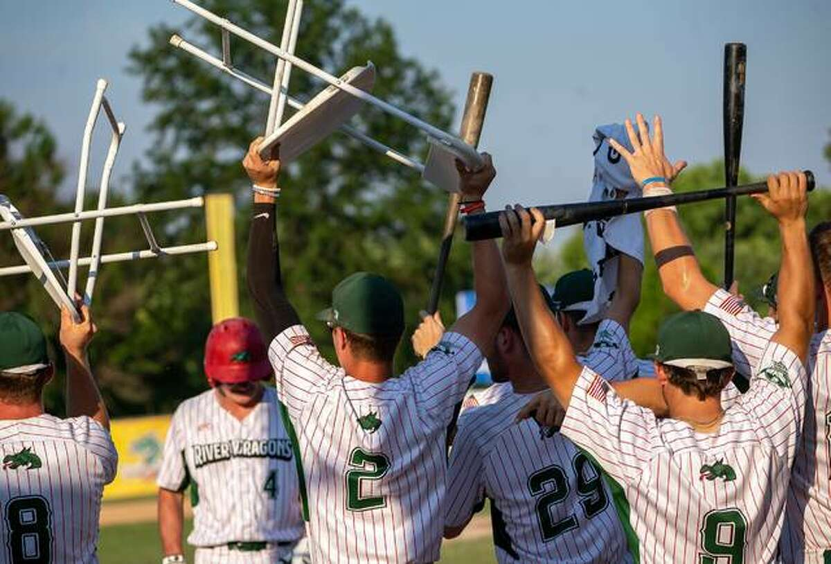 Alton River Dragons players raise their 'rally chairs' in the dugout during Sunday night's 5-1 win over the Springfield Sliders at Lloyd Hopkins Field.