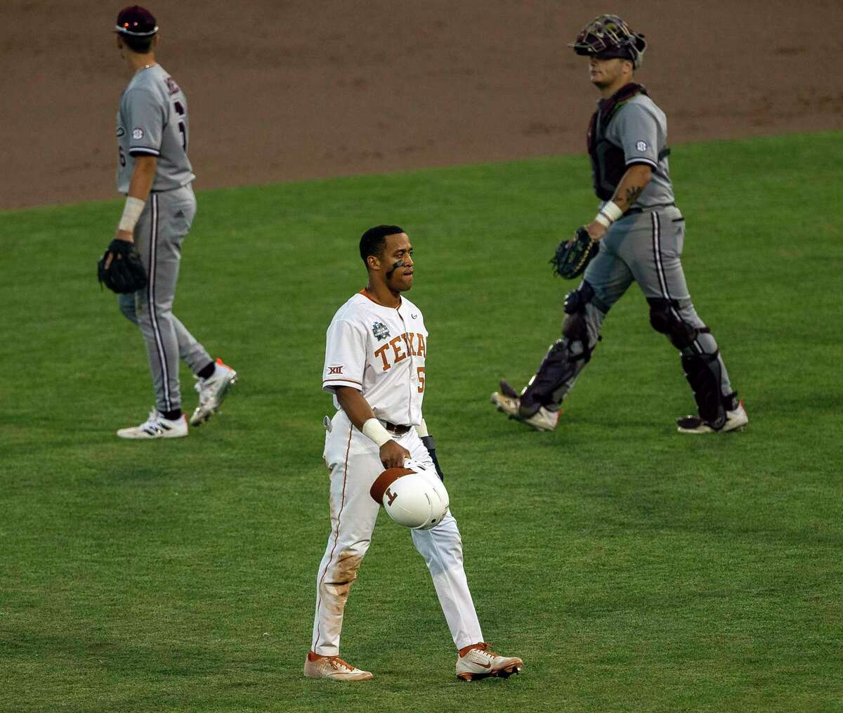 Texas' Camryn Williams (55) walks across the infield after the loss to Mississippi State in a baseball game in the College World Series, Sunday, June 20, 2021, at TD Ameritrade Park in Omaha, Neb. (AP Photo/John Peterson)