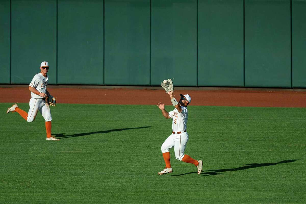Texas outfielder Mike Antico (5) makes a catch against Mississippi State in the fourth inning of a baseball game in the College World Series, Sunday, June 20, 2021, at TD Ameritrade Park in Omaha, Neb. (AP Photo/John Peterson)