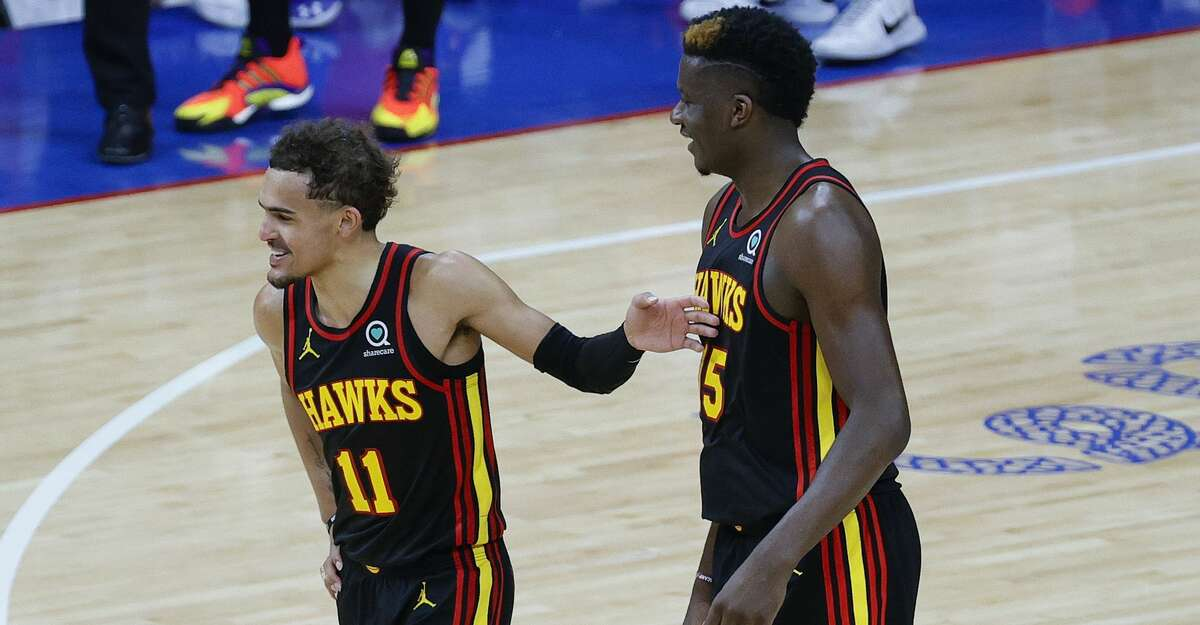 Trae Young (11) and former Rockets center Clint Capela helped the Hawks make it to Game 6 of the Eastern Conference finals before losing to the eventual champion Bucks.