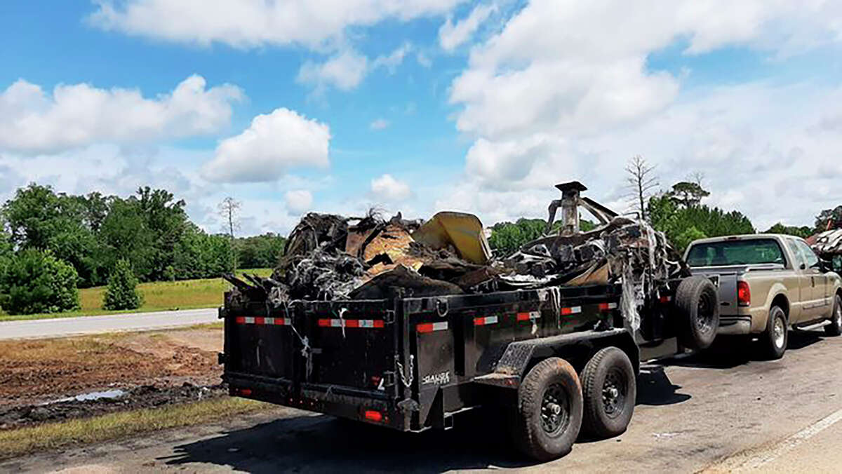 Some of the wreckage from a fatal multiple-vehicle crash a day earlier is loaded to be carried away, Sunday, June 20, 2021, in Butler County, Ala. (Lawrence Specker/Press-Register/AL.com via AP)