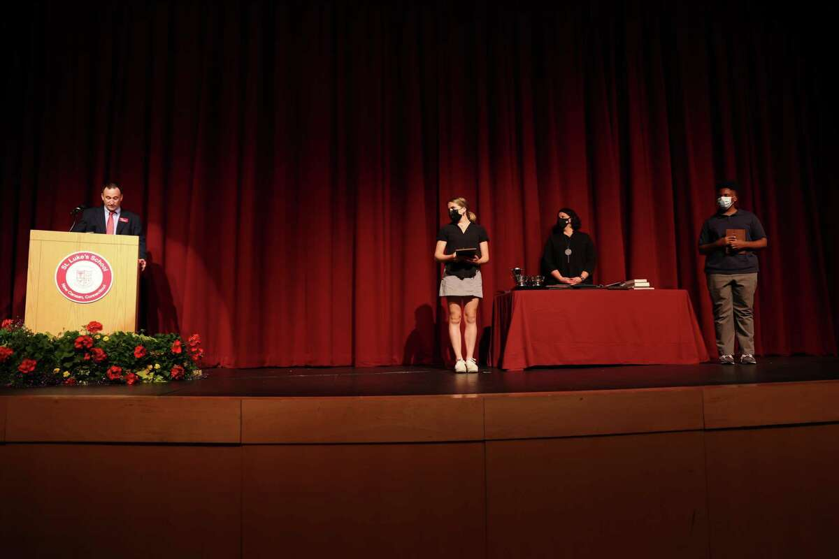 David Parsons, St. Luke's School Upper School History Teacher and 10th grade Co-Dean, presents the 2021 Leadership Award to Macy Millones, Class of 2023, and Myles Sead, Class of 2023, during the school's recent Upper School Awards Ceremony, which took place at the school in New Canaan.