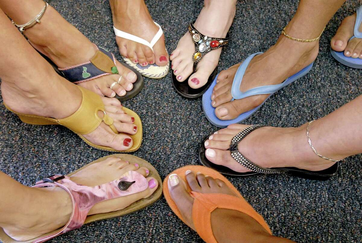 Women wearing flip flops to work.