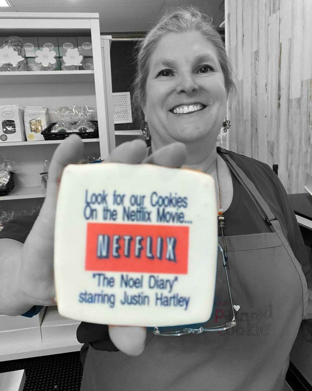 """Susan Schmitt, owner of The Painted Cookie in Wilton, Conn., was contacted by a prop manager for the Netflix movie, """"The Noel Diary,"""" which has been filming in Connecticut with Justin Hartleyand Treat Williams."""