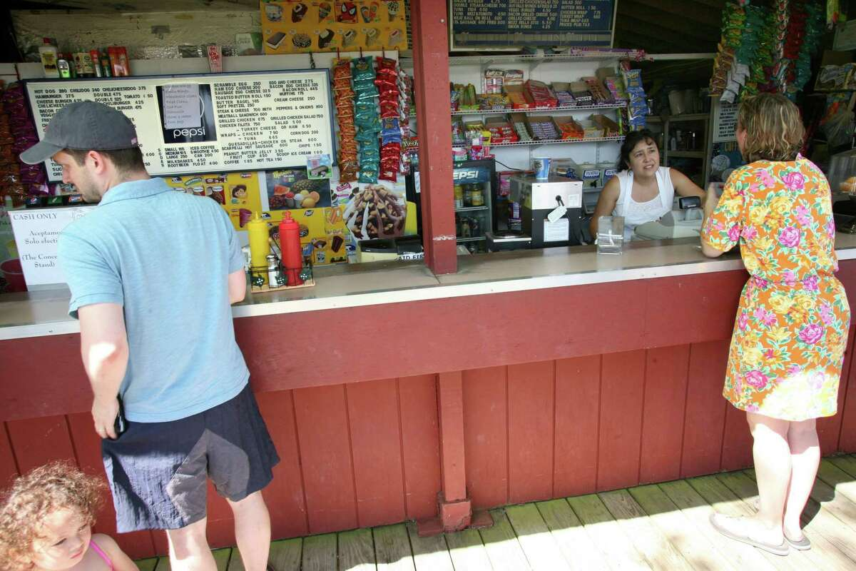 Visitors at the Island Beach concession stand on July, 6, 2012.
