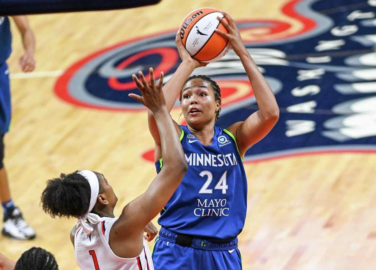 Minnesota Lynx forward Napheesa Collier (24) shoots over Washington Mystics guard Kiara Leslie during the first half on June 8.