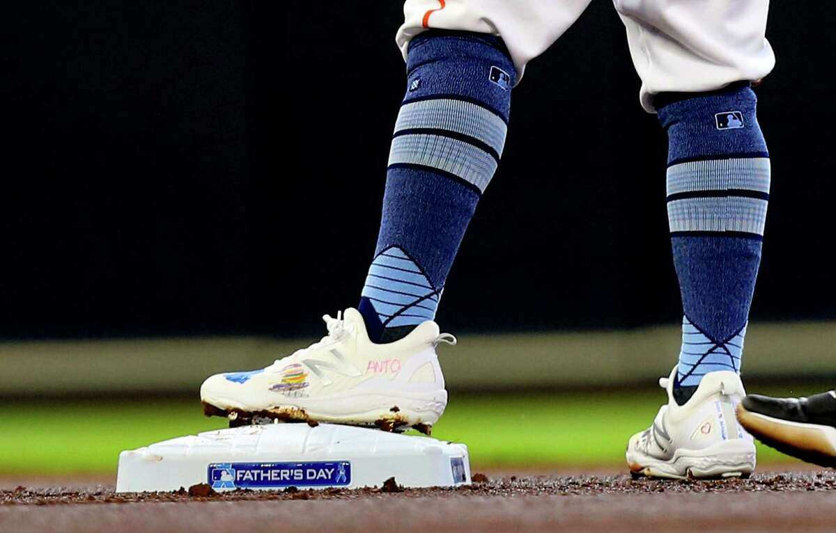 Houston Astros second baseman Jose Altuve (27) wears shoes decorated by his daughter in the first inning against Chicago White Sox at Minute Maid Park in Houston on Sunday, June 20, 2021. Houston Astros won the game 8-2.