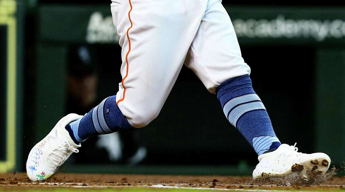 Houston Astros second baseman Jose Altuve (27) wears shoes decorated by his daughter as he goes up to bat in the first inning against Chicago White Sox at Minute Maid Park in Houston on Sunday, June 20, 2021. Houston Astros won the game 8-2.