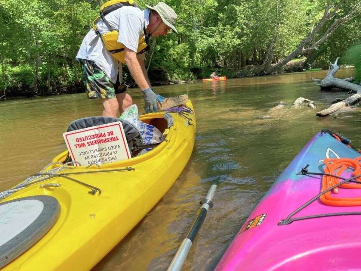 Volunteers with the Benzie Conservation District and theTraverse Area Paddle Clubcleaned up 150 pounds of trash from the Betsie River during the Betsie River Clean Sweep. (Courtesy Photo)