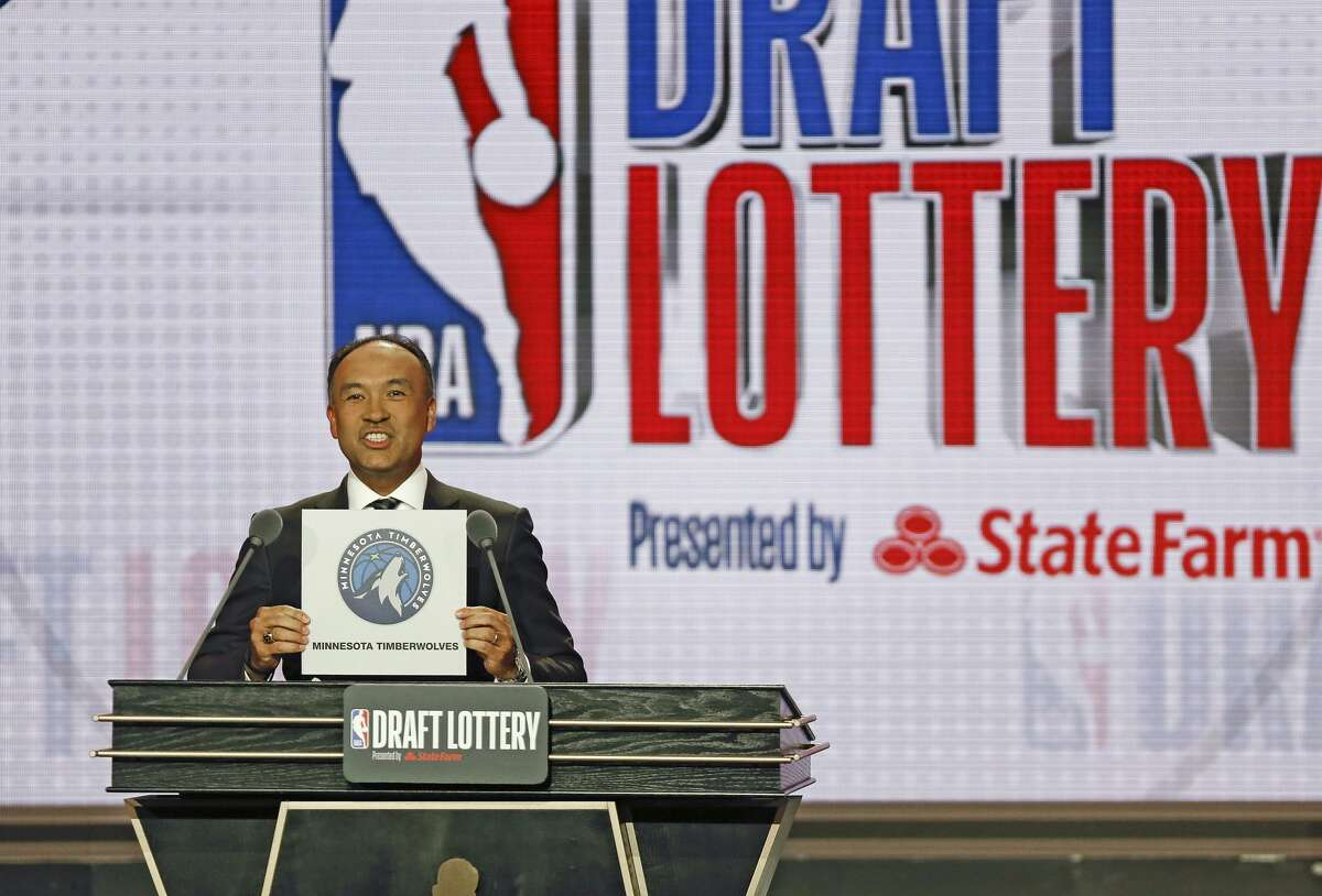 NBA Deputy Commissioner Mark Tatum announces that the Minnesota Timberwolves had won the 11th pick during the NBA basketball draft lottery Tuesday, May 14, 2019, in Chicago.