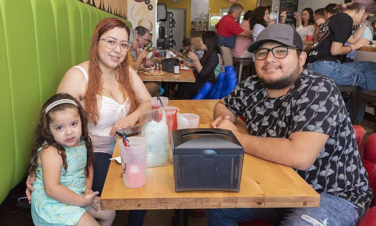 Kamila Moreno, Kristy Moreno and Eduardo Moreno at 550 Pizzeria during the restaurant's one year anniversary celebration.