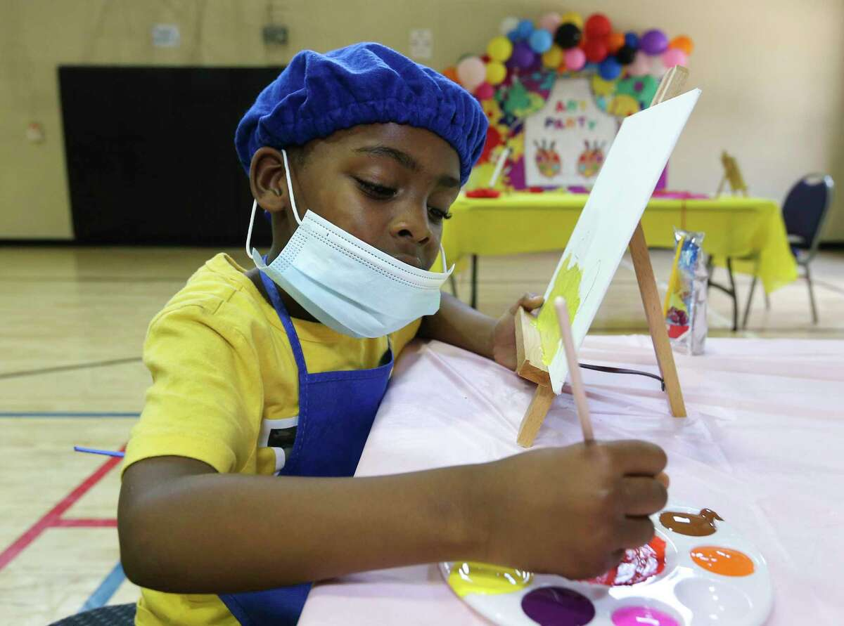 Five-year old Orlanda Hart mixes colors for his painting at day camp Friday, June 11, 2021, at Alief Family YMCA in Houston.