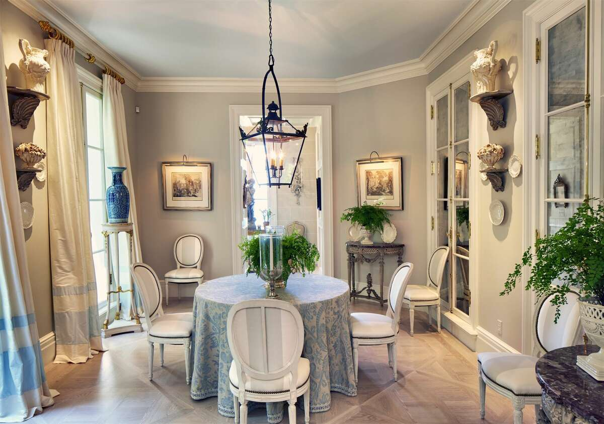 The dining area in the home on 32 Doane Road in Deep River, Conn. has 9-foot ceilings and a parquet floor.