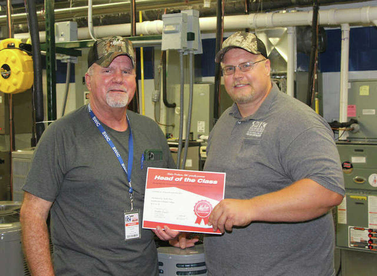 Southwestern Illinois College Heating, Ventilation, Air Conditioning and Refrigeration Program Coordinator Keith Otten, right, presents SWIC HVAR student Donald Rommerskirchen of Highland with the Head of Class award from tool supplier Malco.