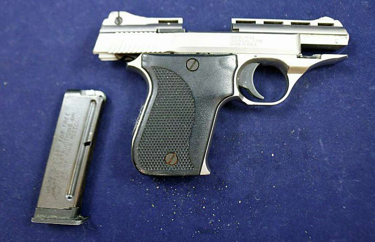 The loaded gun police said was seized during a search and seizure in Waterbury, Conn.