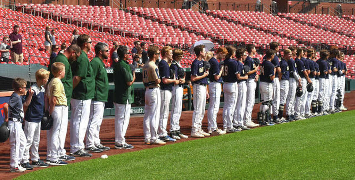 The Father McGivney baseball team stands together for the national anthem before the start of its exhibition game against Metro-East Lutheran at Busch Stadium in St. Louis.