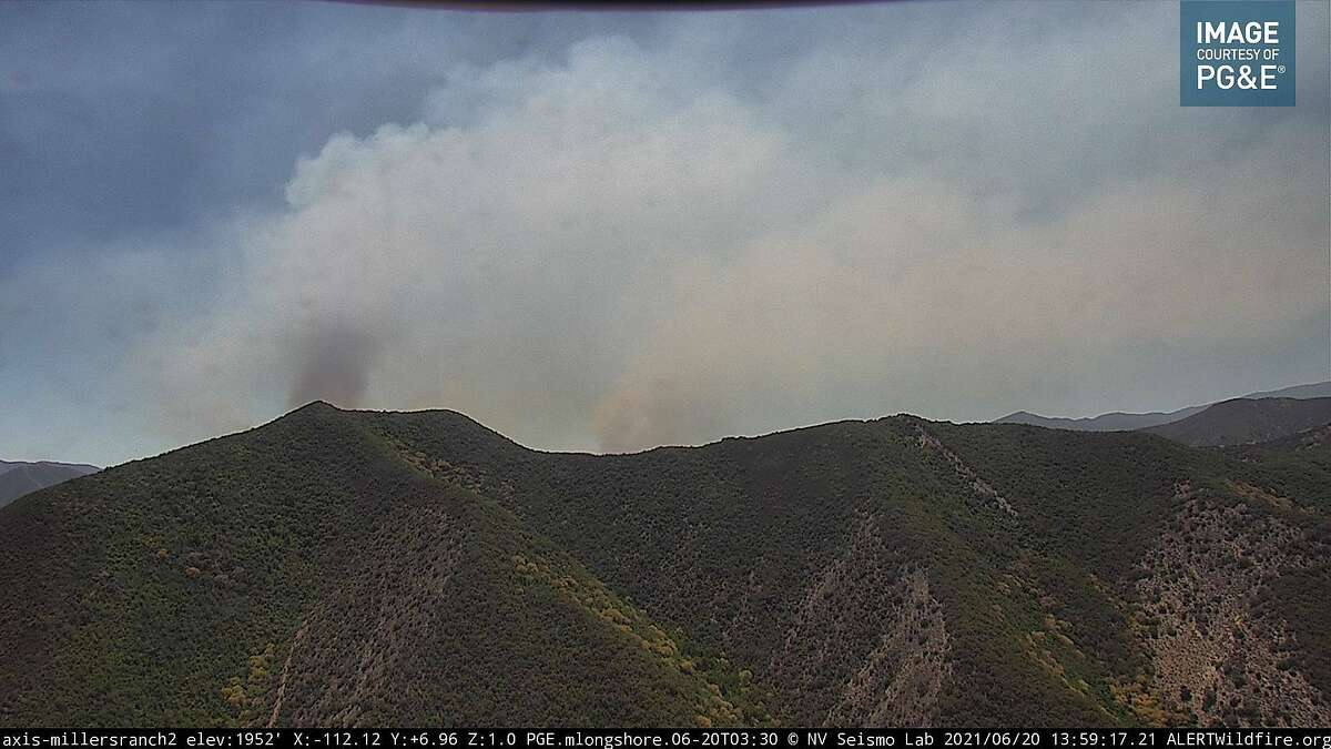 An image from an AlertWildfire camera feed showing the Willow Fire burning near Big Sur. Smoke from the fire was expected to drift north to the Bay Area.