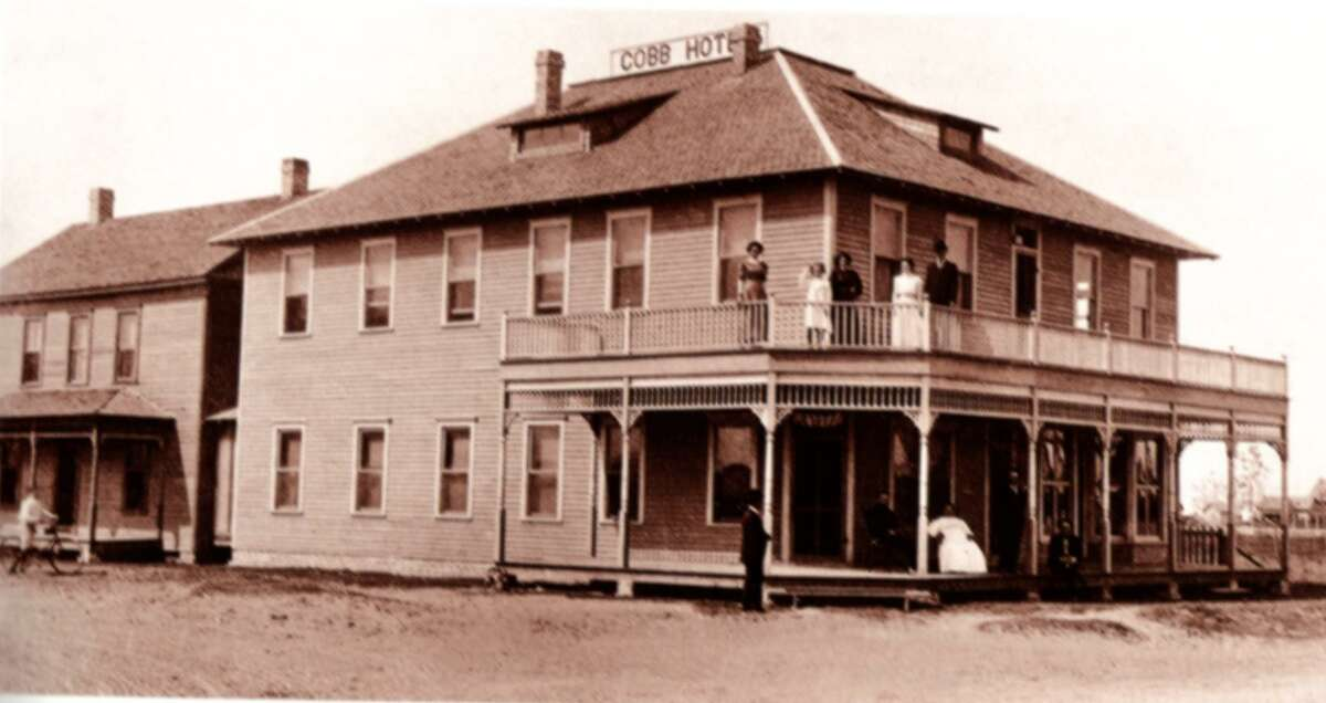 The Featherston House, left, was originally attached to the Cobb Hotel, right. The home was owned by W.H. Featherston, Katy's first paid preacher, and now resides at Katy Heritage Park. Photo taken in 1911.