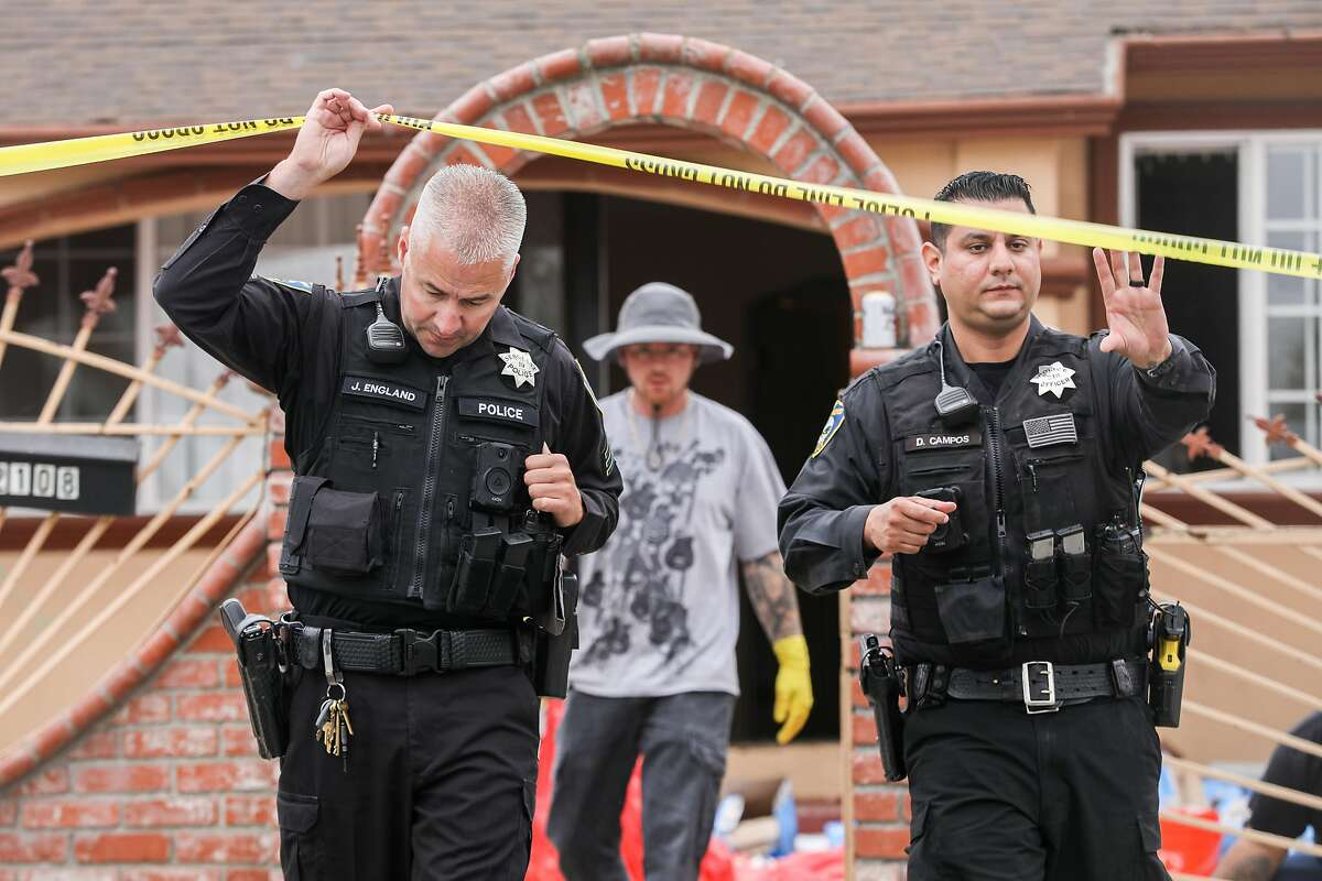 Richmond police officers arrive at the scene where a Sunday evening shooting left three people dead and five injured in Richmond.