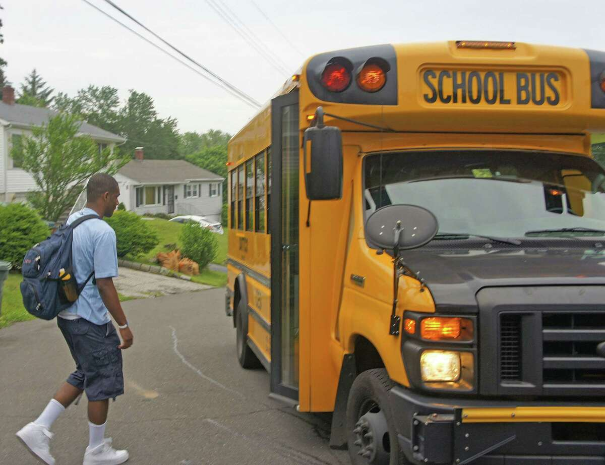 A student gets on a school bus in Bridgeport.